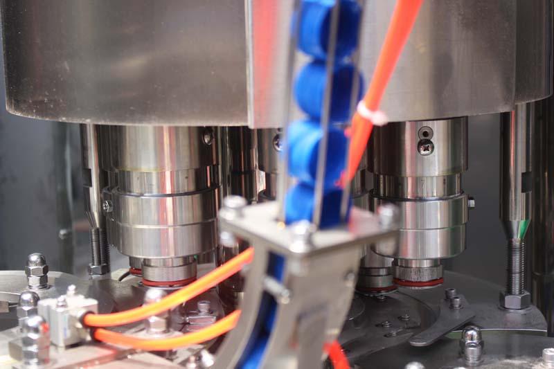 Cap loading machine